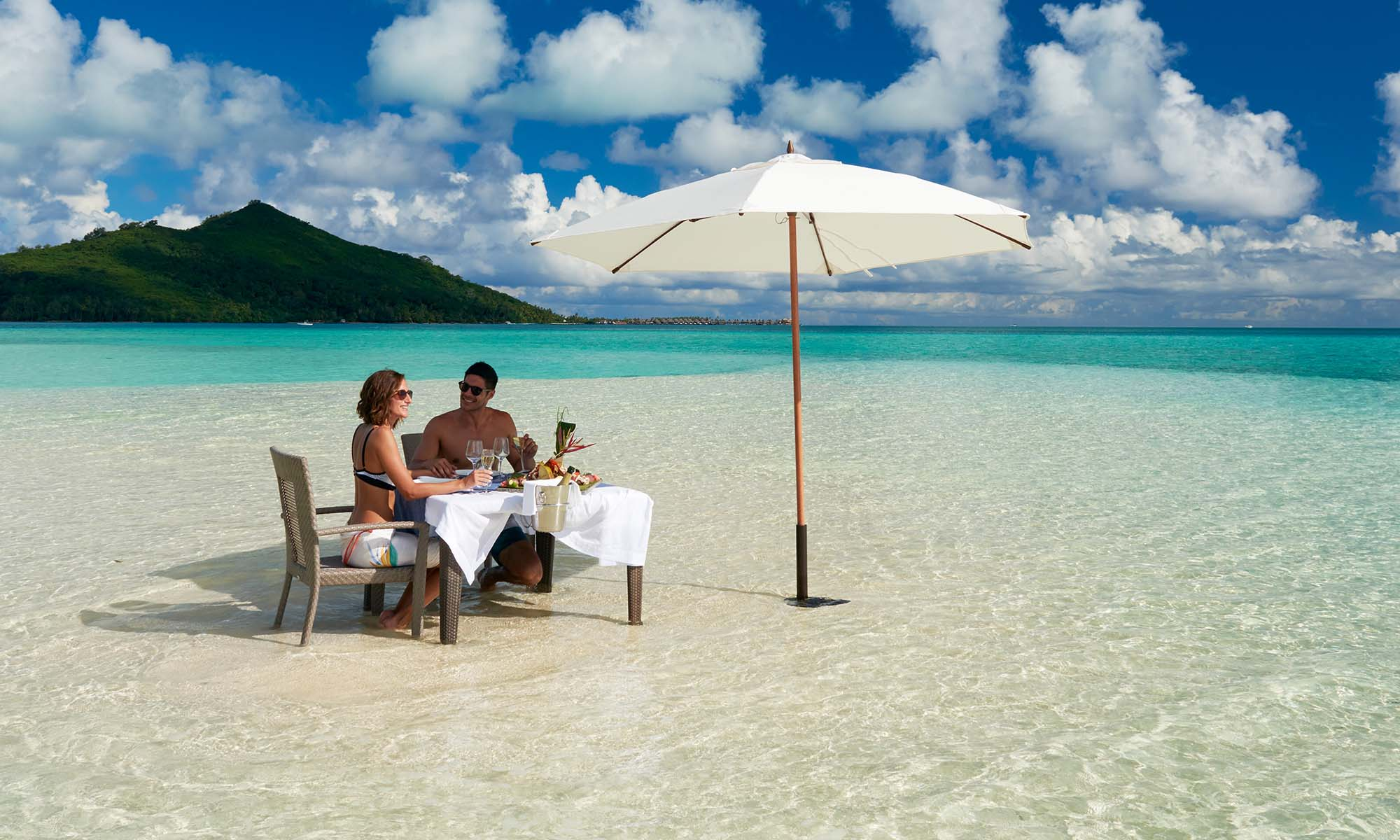 Enjoy a private meal with your feet in the water