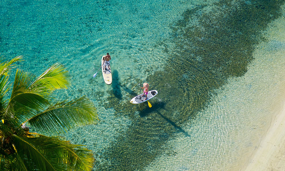 Paddleboarding at the InterContinental Moorea Resort & Spa