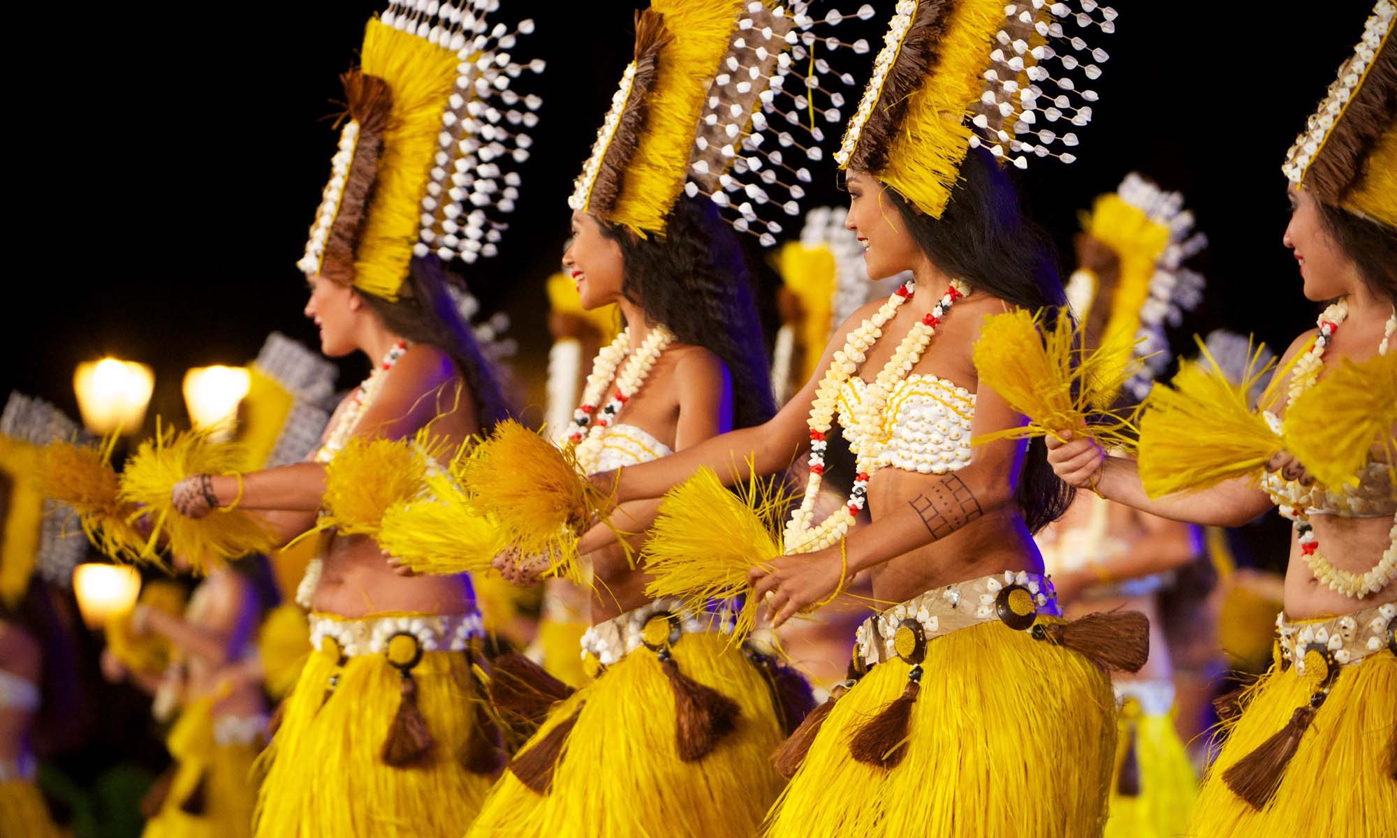 Tahitian Dancers Entertain During a Theme Night at the Resort
