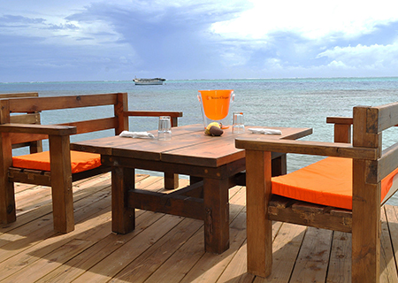 Enjoy a Spectacular Sunset View at Moorea Beach Cafe