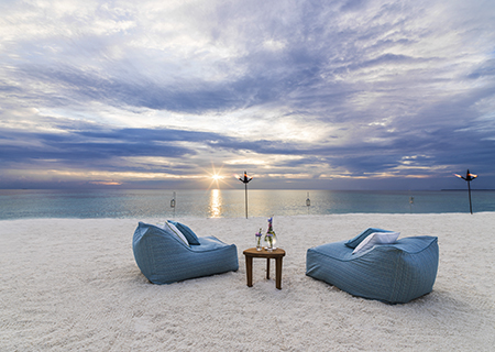 Enjoy the sunset from your own sandbank in the Maldives