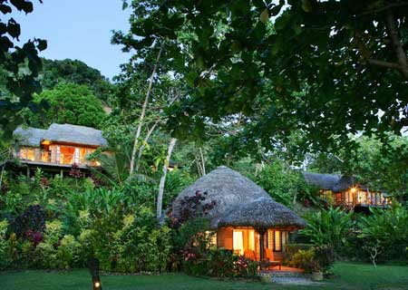 Matangi Private Island Resort, Fiji, Bures at Dusk